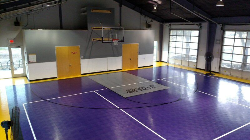 Gymnasium Upgrades for Children's Shelter with Volleyball Stripes