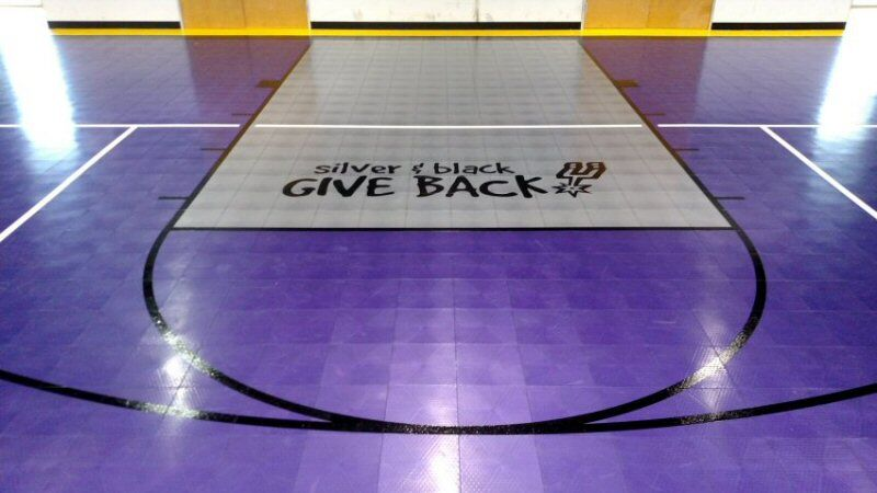 The Silver and Black Give Back Logo was painted on the gym floor at the Children's Shelter