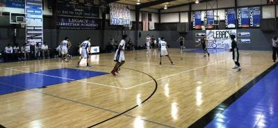 Legacy Christian Academy Boy's Varsity Basketball Team playing on their new Sport Court® High Gloss Response Maple Gym Floor.