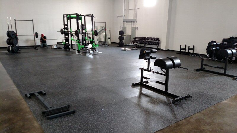 Rubber gym flooring is perfect for weight lifting.