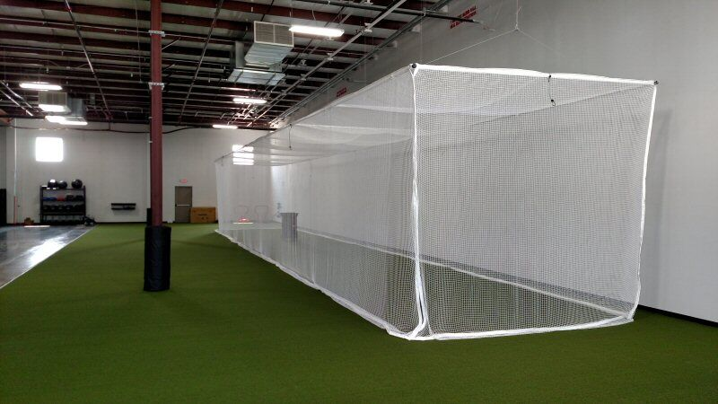 Seventy foot indoor ceiling suspended batting cage